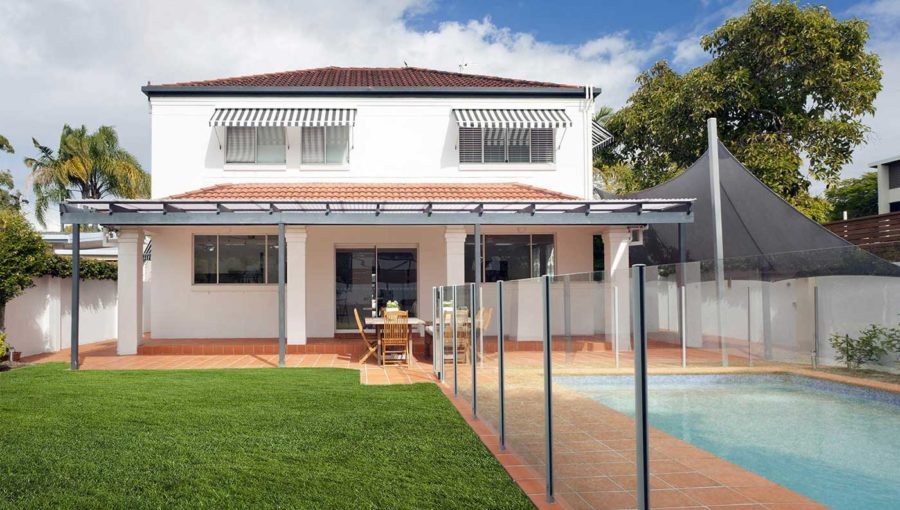 Modern backyard with semi frameless glass fence for swimming pool in Adelaide