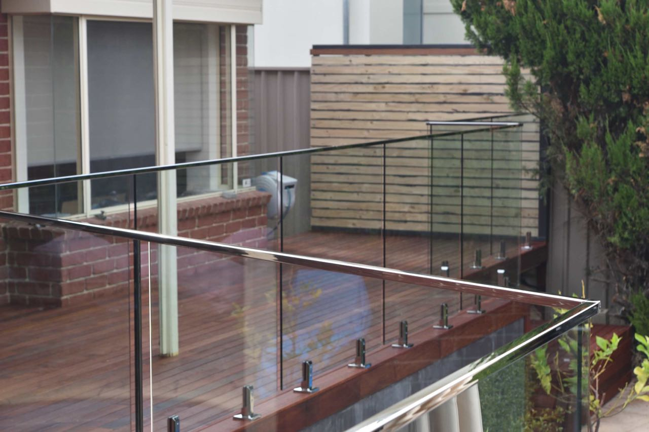 Modern looking, sleek finish top mount hand rails used for one of our Adelaide client's frameless glass balustrade