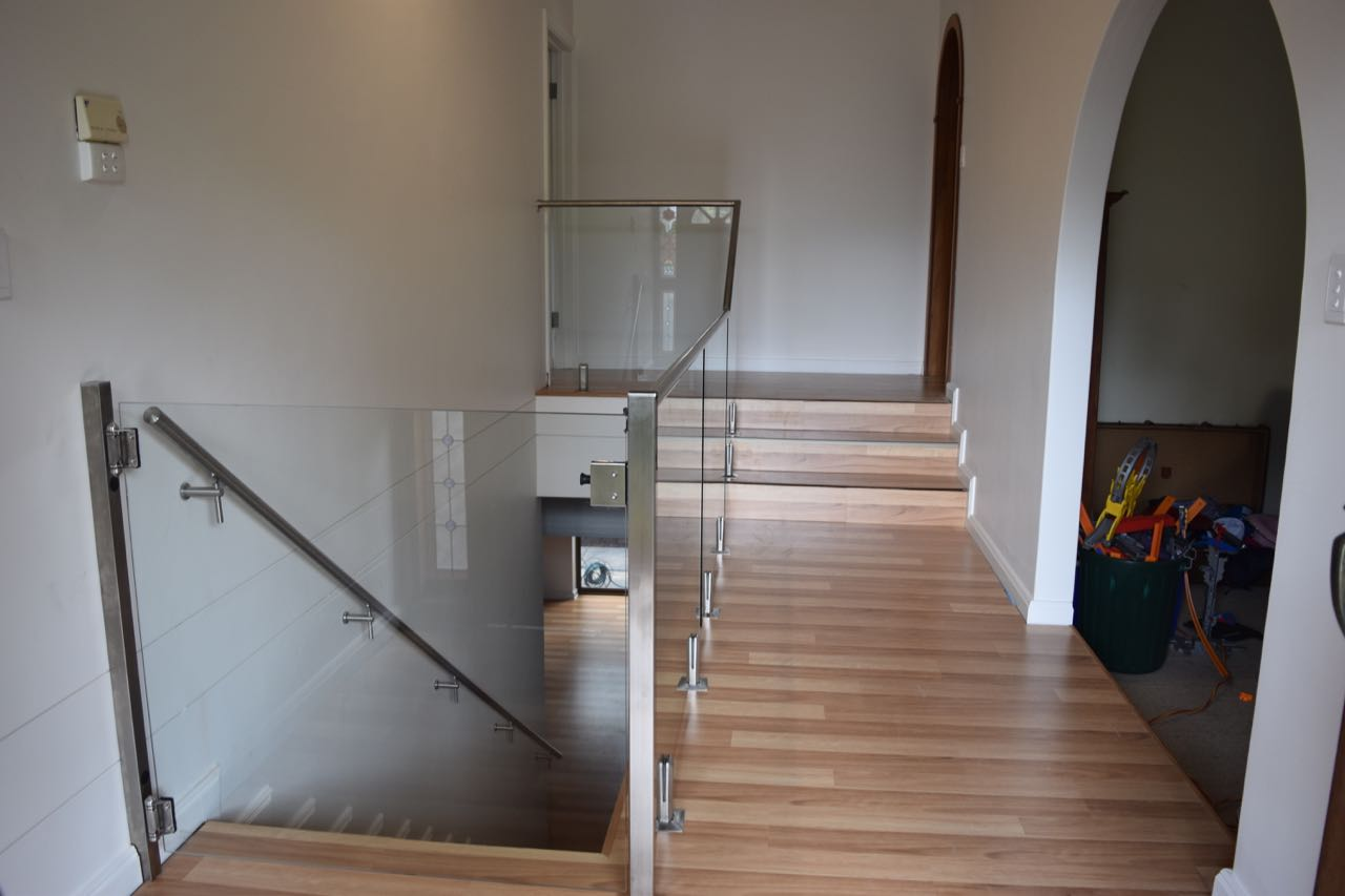 This Parkside client wanted to make their stairs child-safe so we installed a frameless balustrade with soft close, self-latching gate