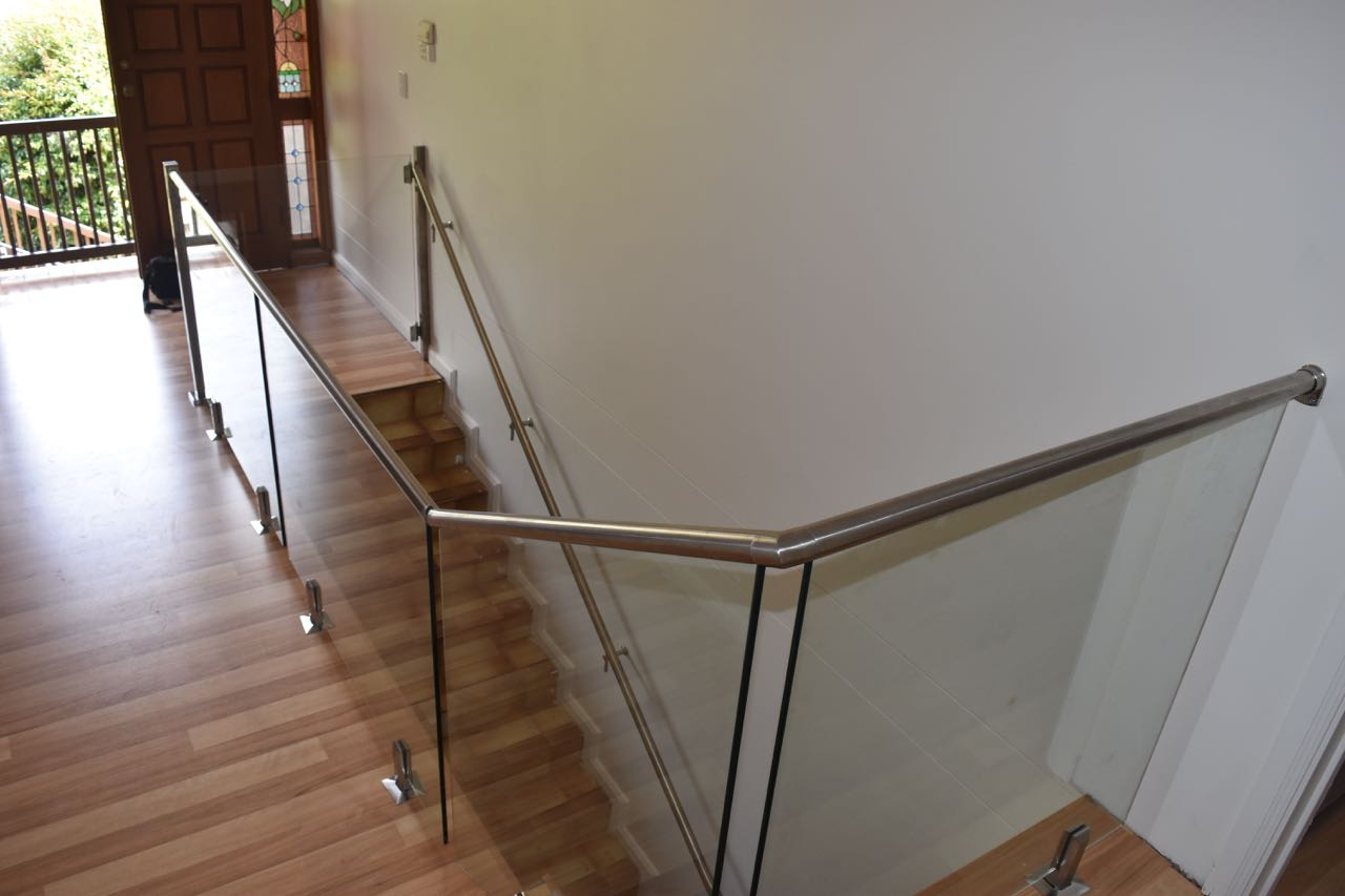 We installed this staircase glass balustrade with marine grade stainless steel top mount hand rail done for a Mount Barker client