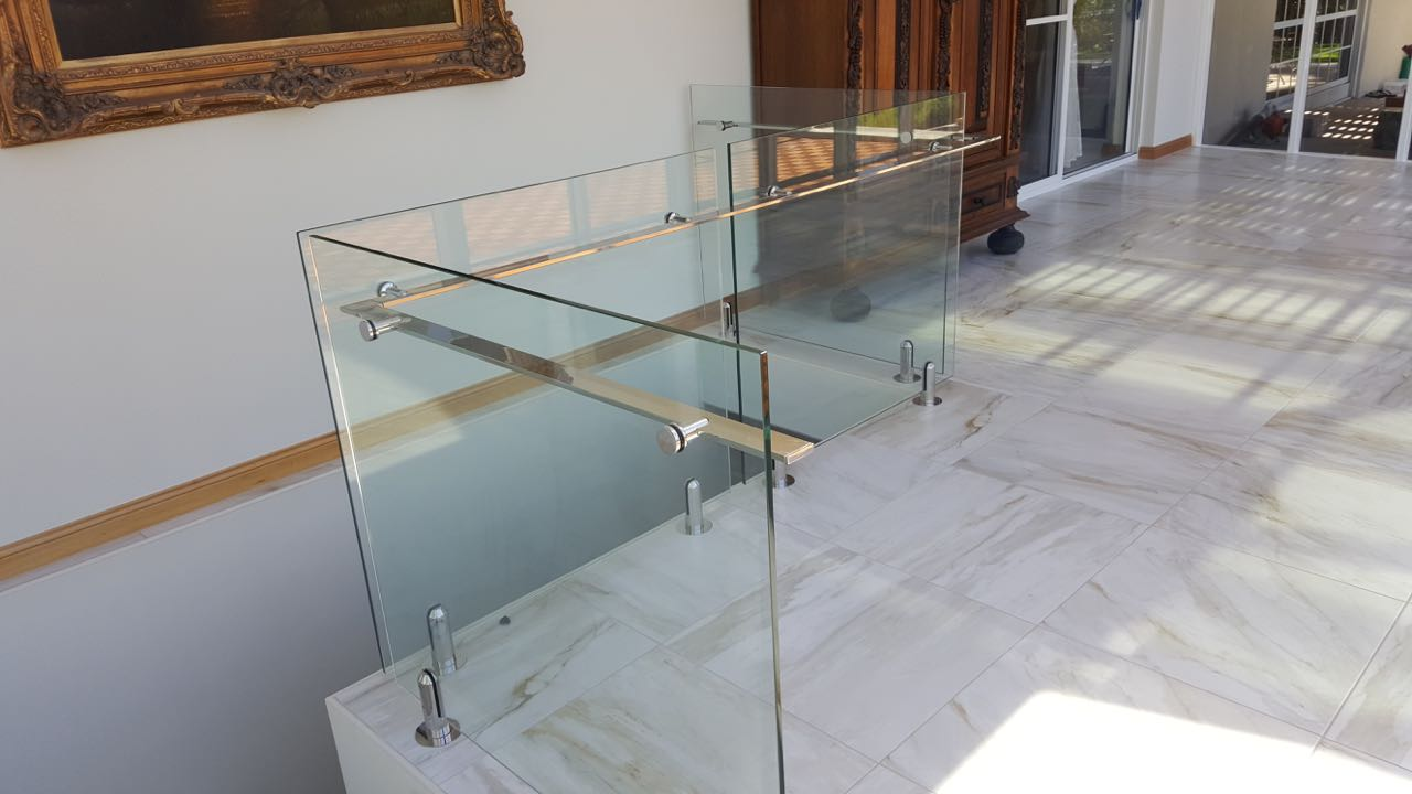 This Unley client opted for a frameless glass balustrade with side-mount stainless steel hand rail for their staircase